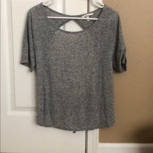Grey basic tee with open back.